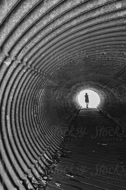 Silhouette of a figure at the end of the tunnel by Preappy for Stocksy United
