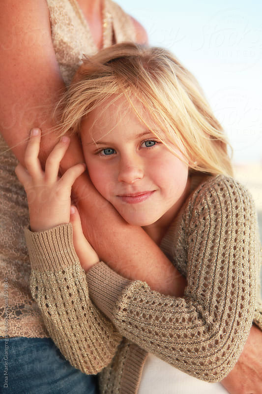 Young blonde girl hugging her mom by Dina Giangregorio for Stocksy United