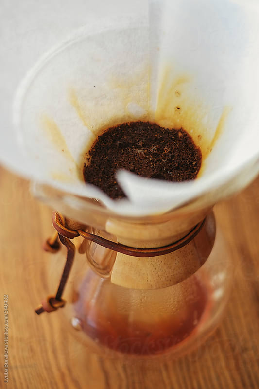 Preparing steaming filter coffee with chemex by Lyuba Burakova for Stocksy United