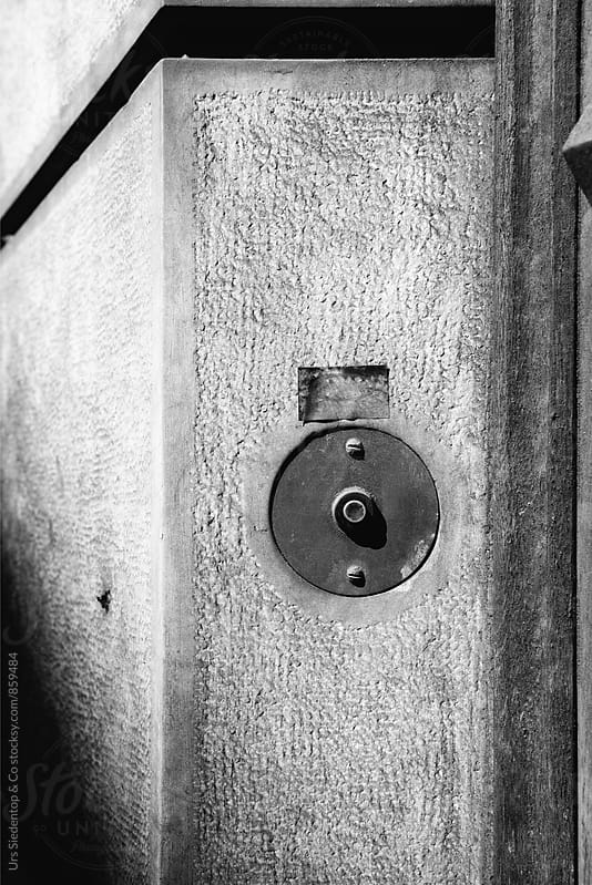 black and white image of doorbell by Urs Siedentop & Co for Stocksy United