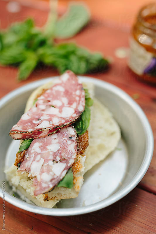 Salami sandwich by Simone Anne for Stocksy United