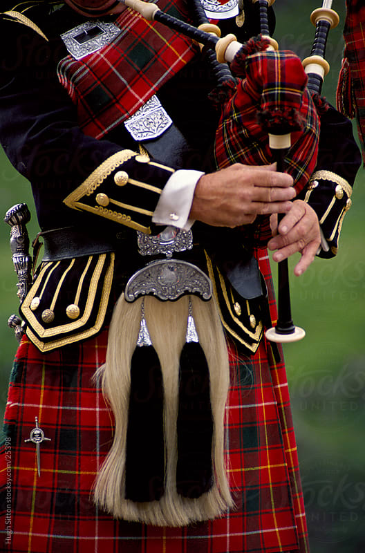close-up of Scottish Bagpiper. Scotland. by Hugh Sitton for Stocksy United