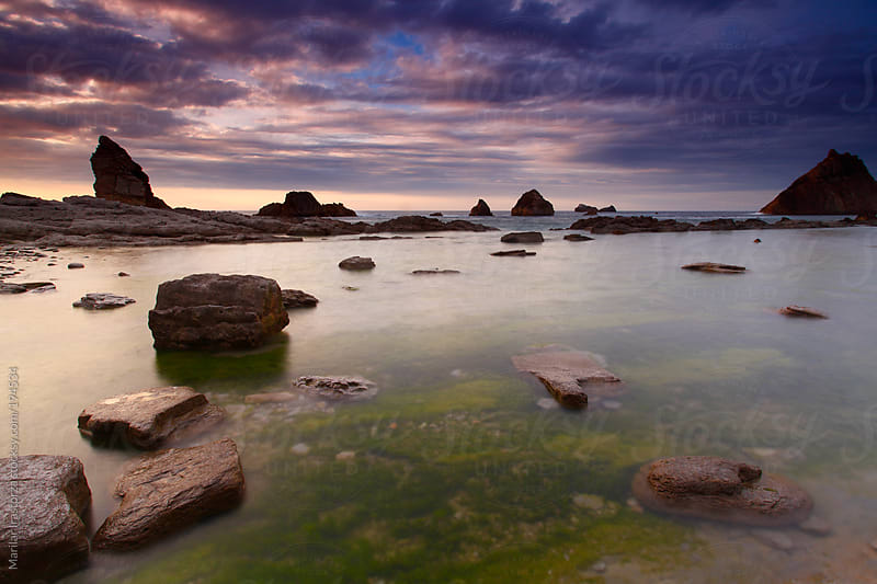 Sunset at low tide by Marilar Irastorza for Stocksy United