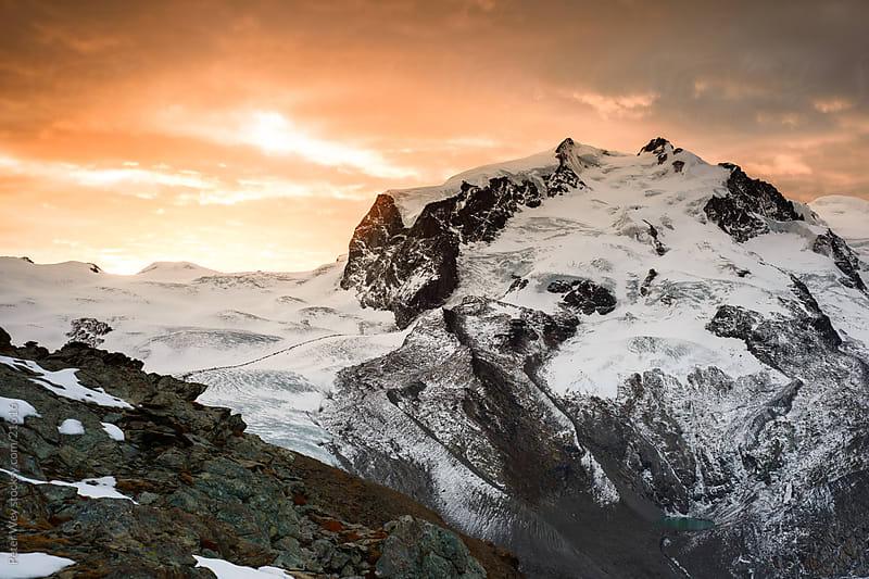 Mountains of Switzerland, Zermatt, Gornergrat: Monte Rosa at sunrise by Peter Wey for Stocksy United