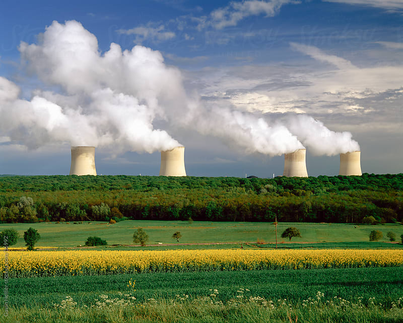 Cooling towers and Oil Seed field, Champagne region, France by Gavin Hellier for Stocksy United