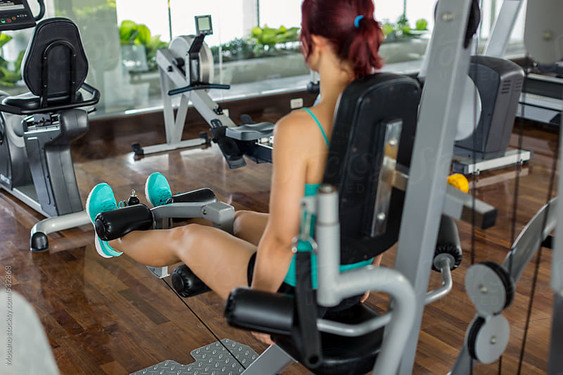 Woman Exercising Legs in the Gym by Mosuno for Stocksy United