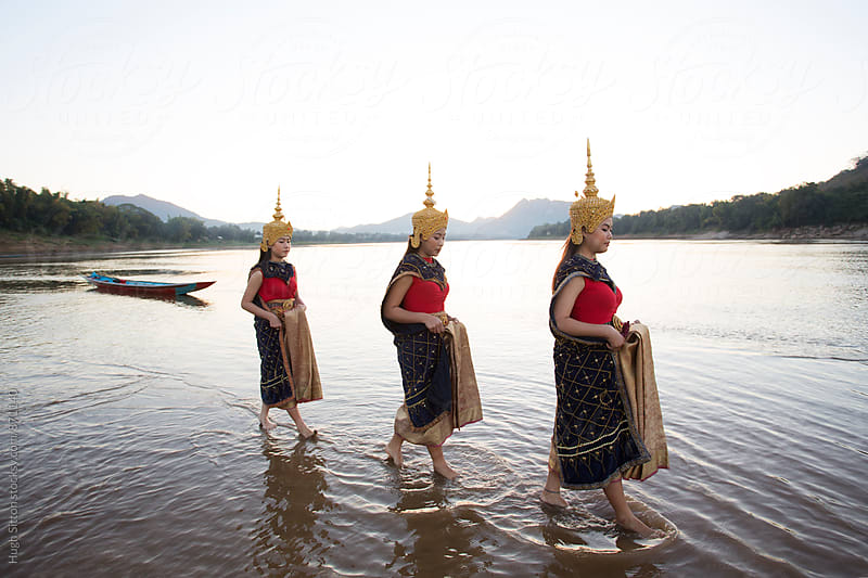 Three traditional Dancers at the Mekong River. Laos. by Hugh Sitton for Stocksy United