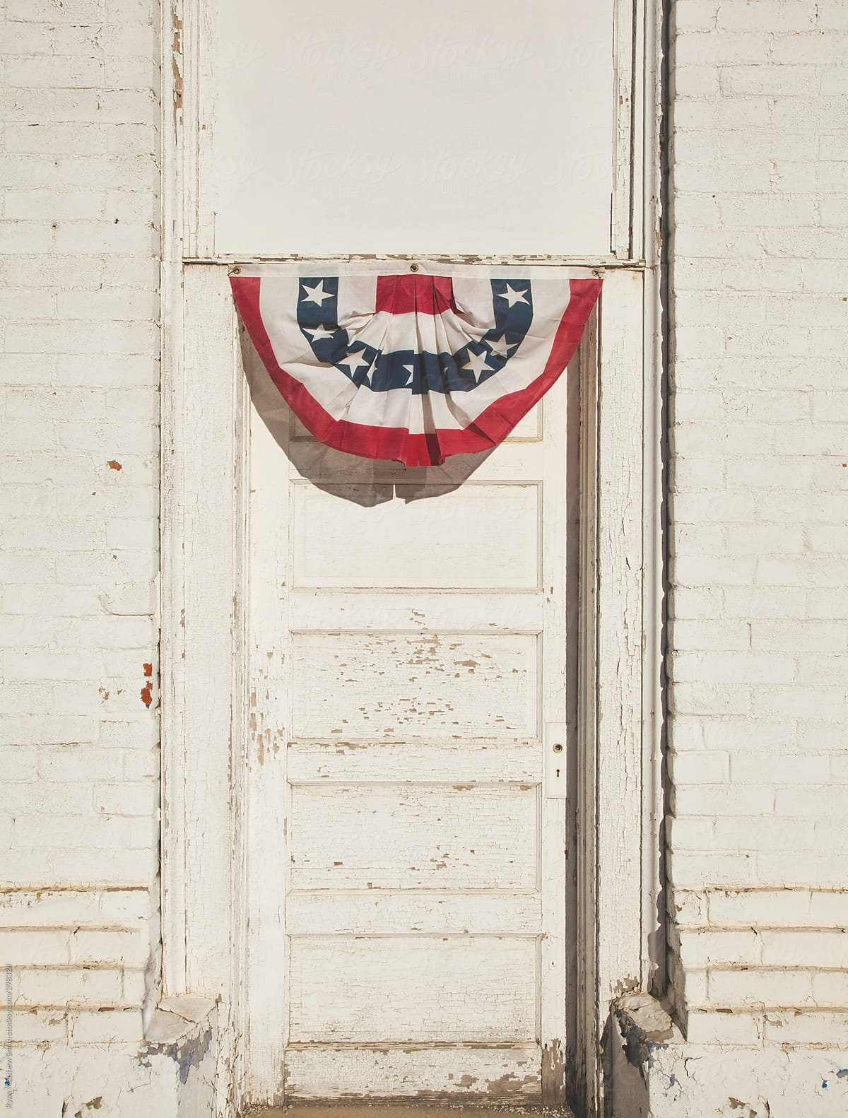 American Flag Fan Over Old White Door By Ryan Matthew Smith For Stocksy  United
