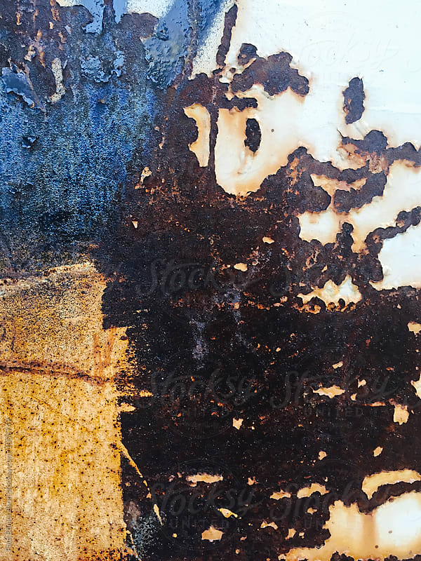 Close up of rusty metal wall with scratch marks and peeling paint by Paul Edmondson for Stocksy United
