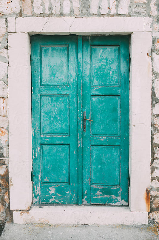 Old turquoise wooden doors by Maja Topcagic for Stocksy United