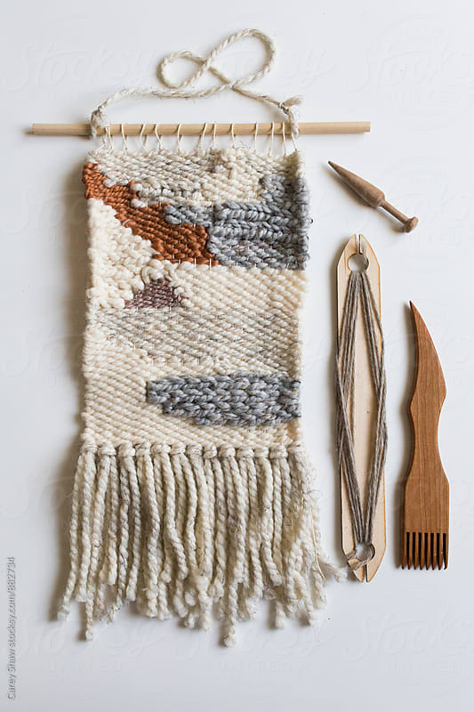 Wall weaving and wood tools by Carey Shaw for Stocksy United