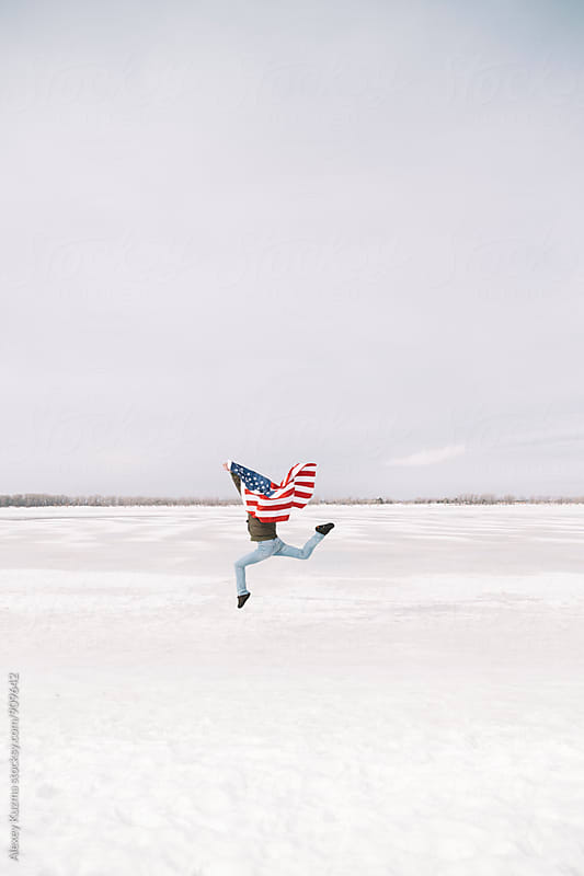 young man with USA flag  by Vesna for Stocksy United