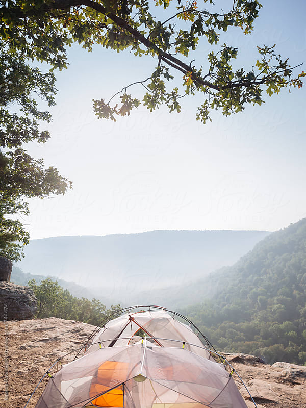 Tents set up on cliff edge. Hawksbill Crag, Arkansas. by Jeremy Pawlowski for Stocksy United