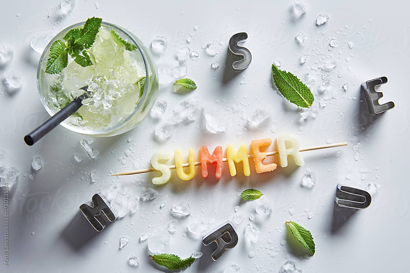 Summer word on stick made of exotic fruit by Martí Sans for Stocksy United