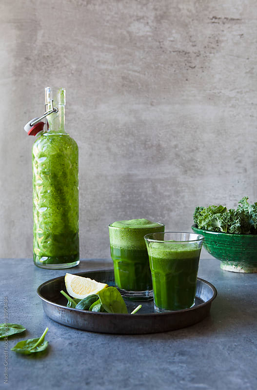 Freshly pressed green juice by Nadine Greeff for Stocksy United