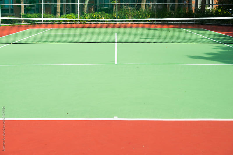 Tennis court with net by Lawren Lu for Stocksy United