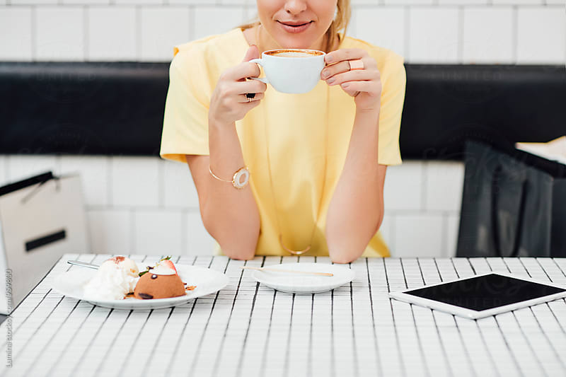 Elegant Woman Drinking Espresso at a Café