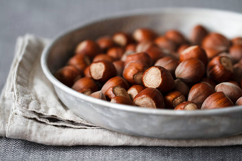 Hazelnuts on a metal plate by Dobránska Renáta for Stocksy United