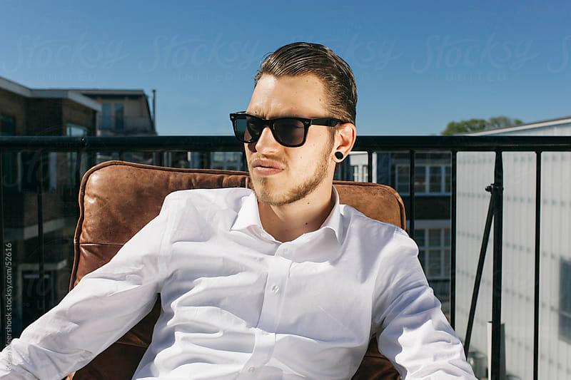 Young man with sunglasses looking serious. by Koen Meershoek for Stocksy United