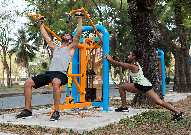 Two People Exercising in an Open Air Gym by Mosuno for Stocksy United