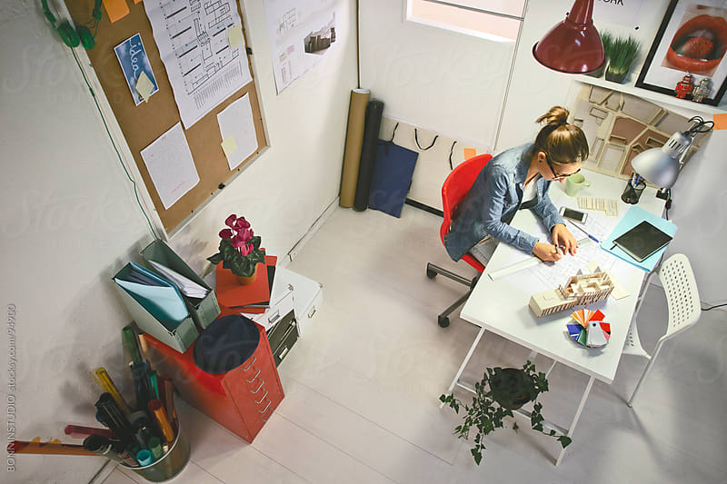 Aerial view of young architect woman working in her office. by BONNINSTUDIO for Stocksy United