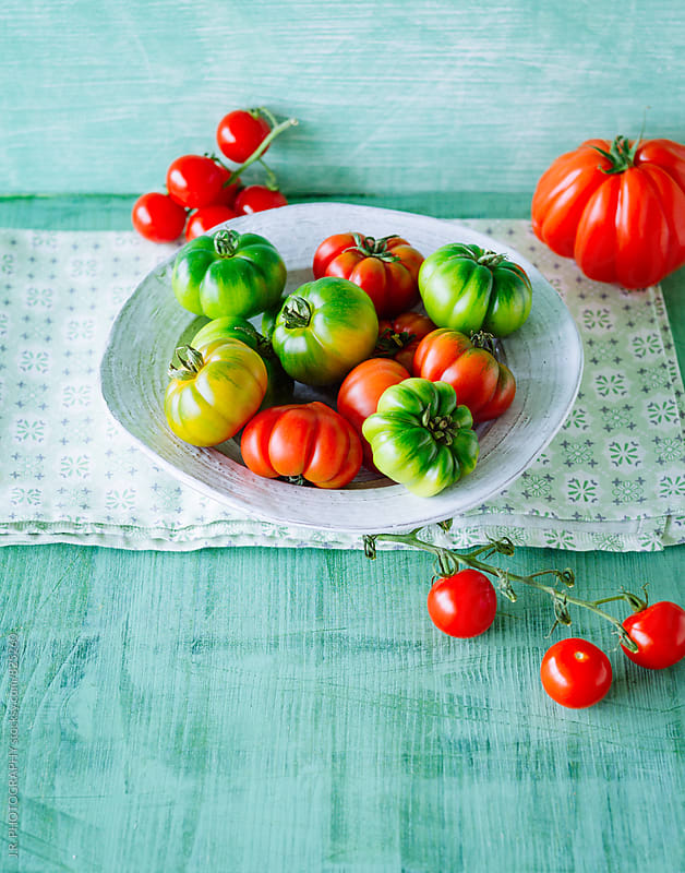 Various tomatoes in bowl by J.R. PHOTOGRAPHY for Stocksy United