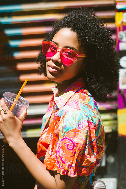 Cool woman in pink colorful sunglasses by Lauren Naefe for Stocksy United