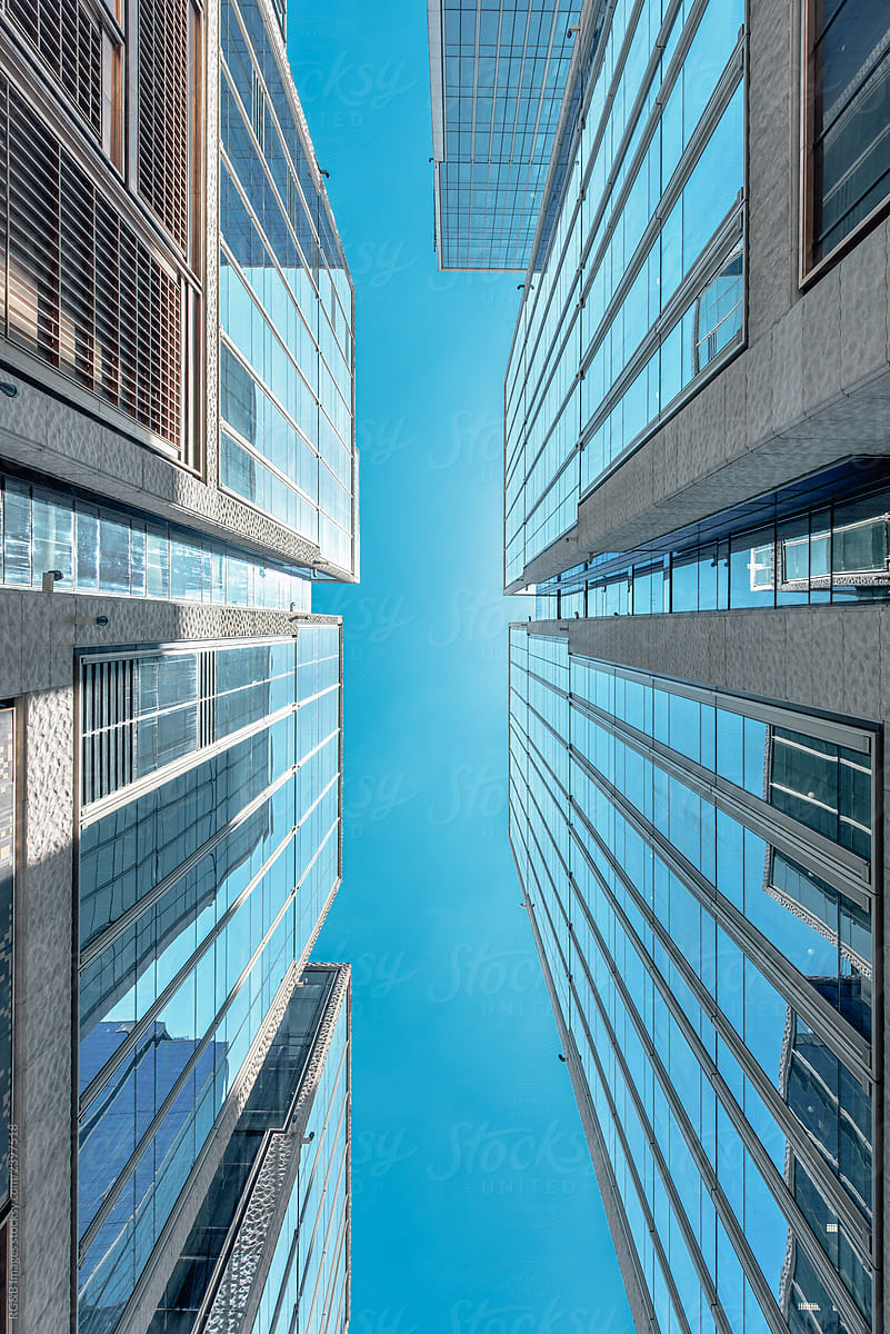 Below view of office buildings by Ibex.media - Stocksy United