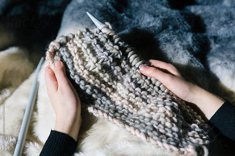 Girls hands holding chunky knit, knitting project by Jacqui Miller for Stocksy United