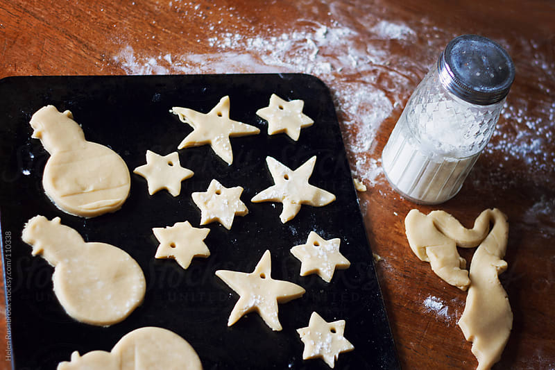 Biscuits ready for baking by Helen Rushbrook for Stocksy United
