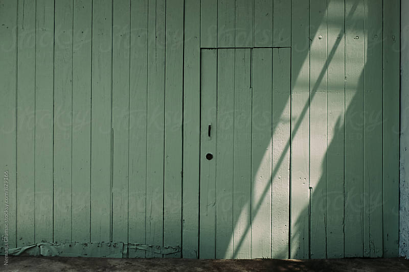 Green Wooden Wall With a Door in Bangkok by Nemanja Glumac for Stocksy United