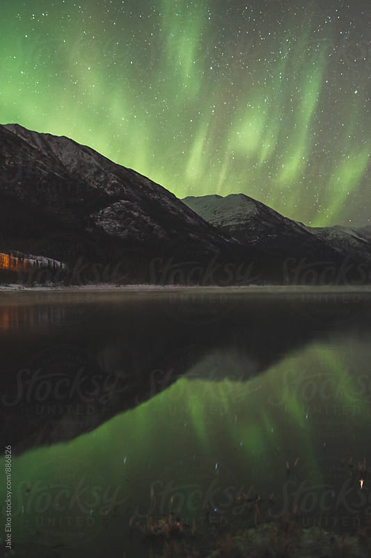 Raging Eklutha Northern Lights by Jake Elko for Stocksy United
