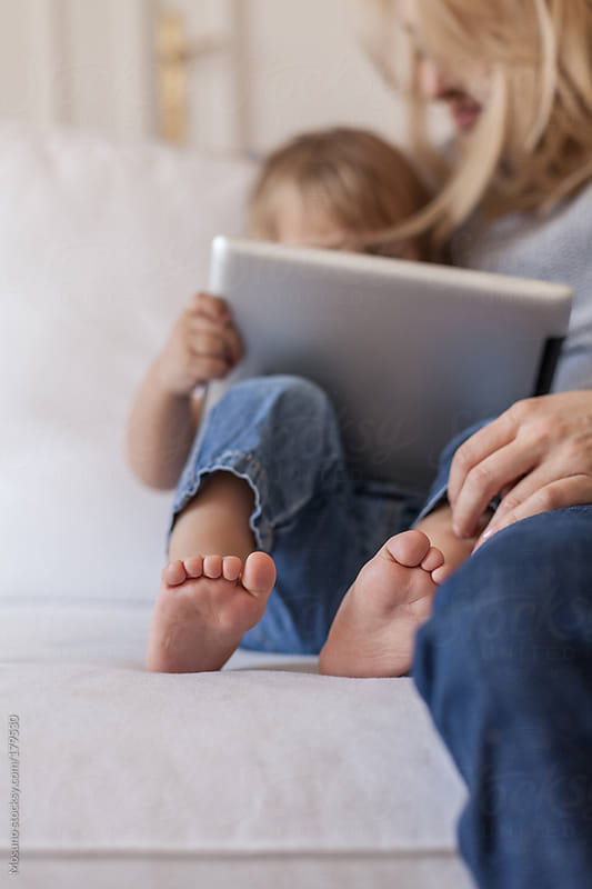 Mother and Son Playing on Tablet Computer by Mosuno for Stocksy United