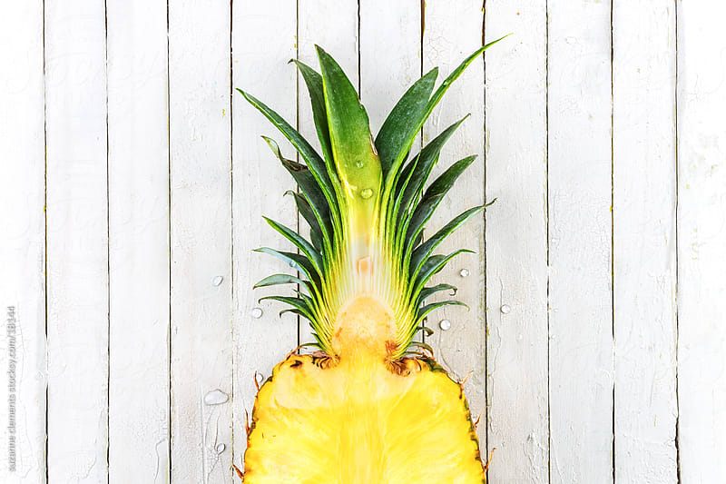 Freshly Sliced Organic Pineapple by suzanne clements for Stocksy United