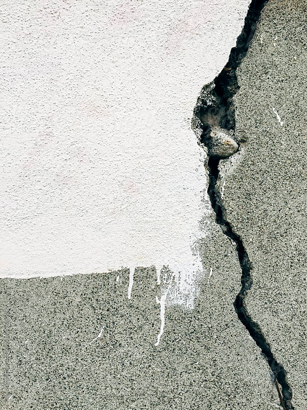 Crack on cement wall, paint, covering graffiti tags by Paul Edmondson for Stocksy United