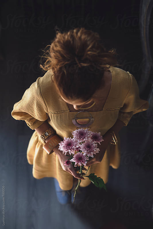 Ginger-Haired Woman Holding a Flower Bouquet by Lumina for Stocksy United
