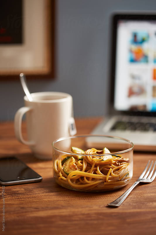 Pasta lunchbox at work by Martí Sans for Stocksy United