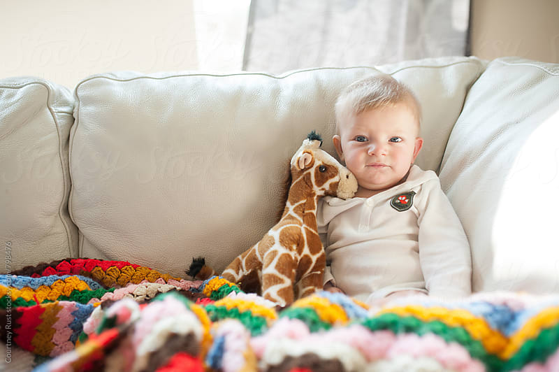 Baby and Giraffe by Courtney Rust for Stocksy United