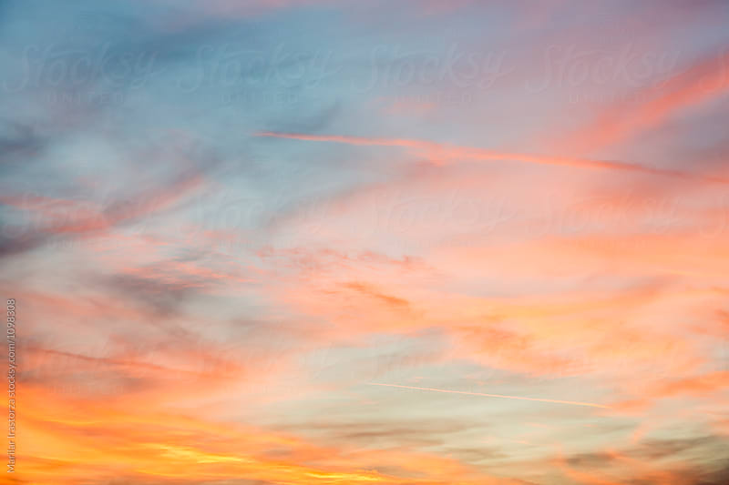 Colorful clouds at sunset by Marilar Irastorza for Stocksy United