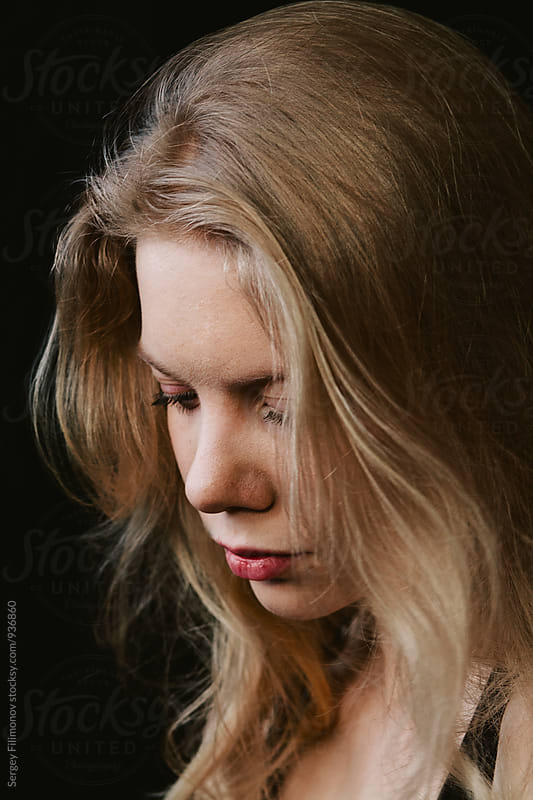close up portrait of a beautiful young blonde girl by Sergey Filimonov for Stocksy United