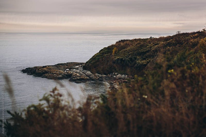 Ocean cliff at sunset by Ania Boniecka for Stocksy United