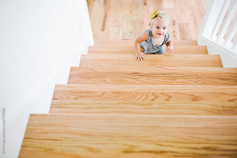 toddler crawling on stairs by Erin Drago for Stocksy United