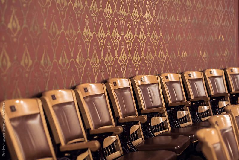 Row of vintage chairs at theater by Per Swantesson for Stocksy United