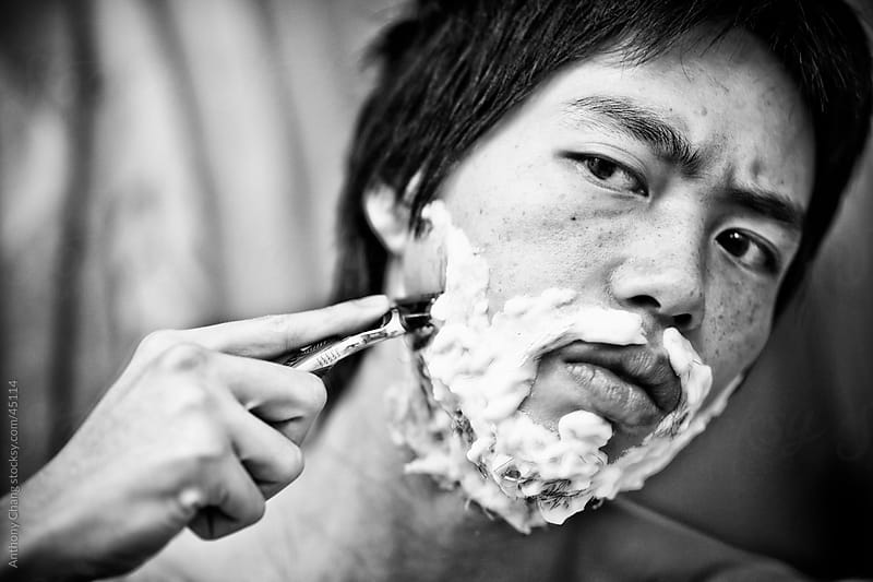 Shaving in Black and White by Anthony Chang for Stocksy United