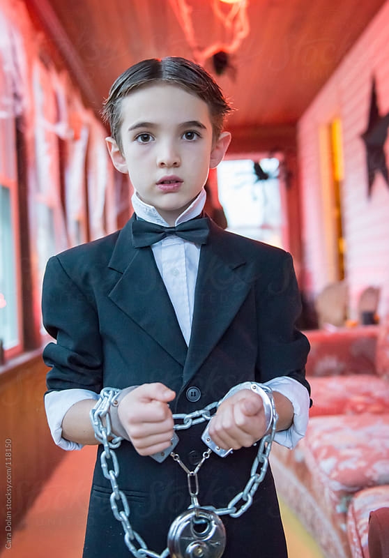 Boy is dressed as an escape artist for Halloween by Cara Dolan for Stocksy United