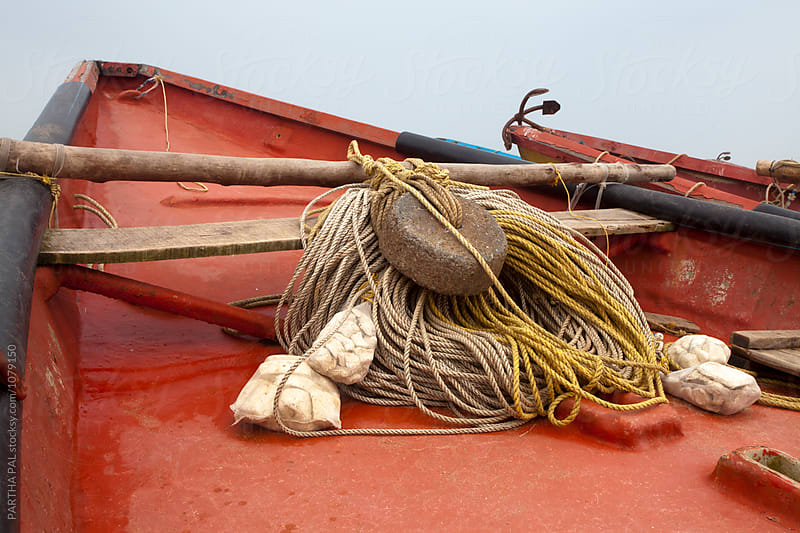 The rope and fishing items resting on a fisherman boat by PARTHA PAL for Stocksy United