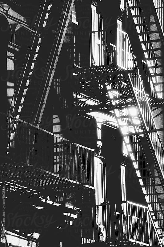 Fire escapes outside of apartment buildings, Greenwich Village, NY, NY by Paul Edmondson for Stocksy United