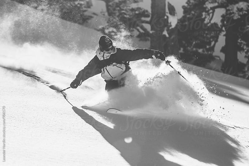freerider skiing in deep powder - black and white by Leander Nardin for Stocksy United