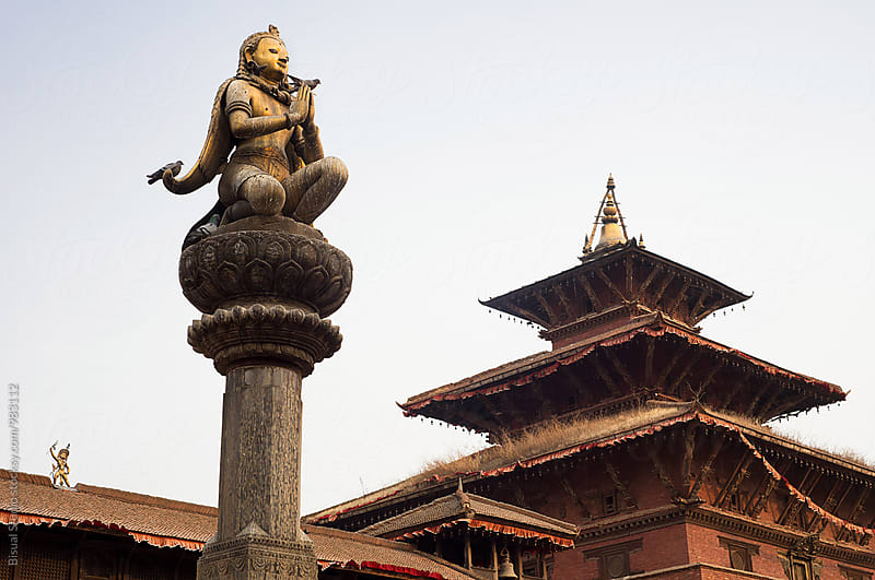 Statue of Garud and nepali palace in Patan by Bisual Studio for Stocksy United