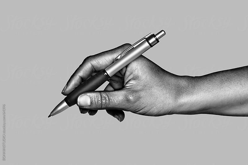 Hand writing with silver pen. Black and white photo. by BONNINSTUDIO for Stocksy United